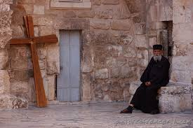 christian priest and cross in jerusalem travel pictures