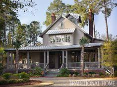 low country house wrap around porch tin roof white picket fence