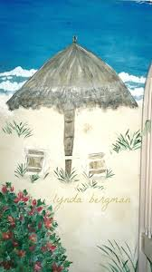 lynda bergman decorative artisan painting a beach scene mural for