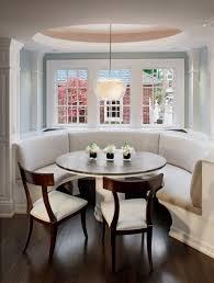 banquette seats dark grey smooth stone floor dark grey kitchen