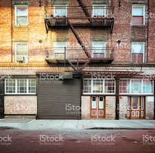 brooklyn apartment buildings facade with large steel garage door