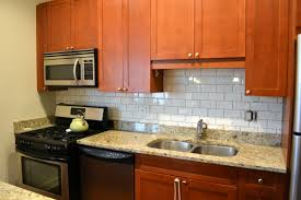 Kitchen Backsplashes 2014 Rustice Beige Subway Tile Backsplash With Skinny Trim Row Placed