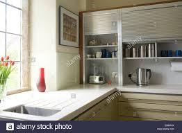 Kitchen Cabinet Shutters Modern Kitchen With Raised Tambour Shutters On Storage Cabinets
