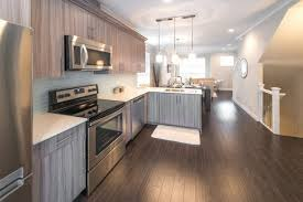 white backsplash dark cabinets white wood surround fireplace mantel dark wood floors with white