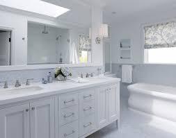 bathroom white cabinets dark floor bathroom white subway tile bathroom dark floor gray to ceiling