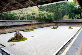 zen rock garden in ryoanji temple kyoto japan in the garden