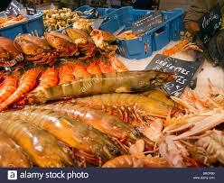 cuisine de r黐e fish on display at the indoor fresh food market in st martin de re