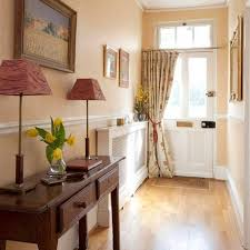 small front hall design with console table with drawers and buffet