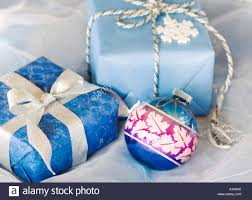 blue vintage ornament with two blue wrapped packages
