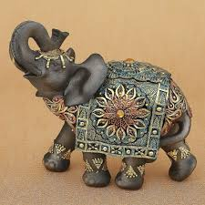 asian elephant ring holder images Mahogany brown elephant with colorful headdress and blanket jpg