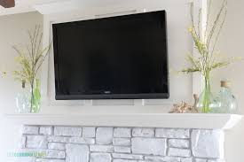 simplicity white washed stone fireplace guest post country