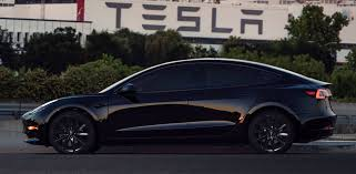 tesla model 3 with 19 inch matte black tst wheels by t sportline