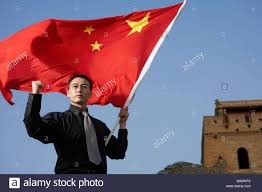 Chineses Flag Man Holding Chinese Flag Stock Photo Royalty Free Image 23812878