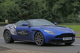 4 door aston martin when prototypes become mobile billboards aston martin db11
