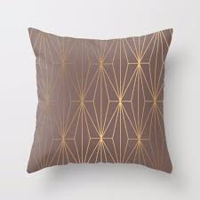 gold geometric pattern over brown background throw pillow cushion