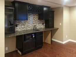 wet bar including custom tile backsplash and wine storage above