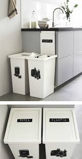 kitchen bin ideas two large white bins next to a kitchen counter are labeled for