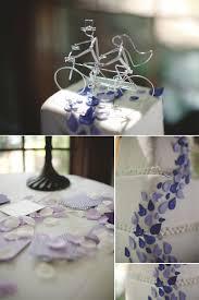 white wedding cake with purple wedding flowers
