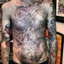 grey ink stomach tattoos for