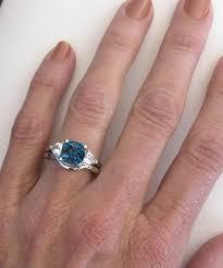 london blue topaz engagement ring cushion cut london blue topaz and trillion white sapphire three