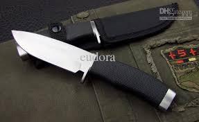 buck 009 straight camping knife white black nylon sheath 55 57hrc