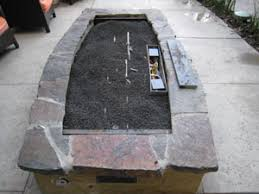 Fire Pit With Lava Rocks - amazingglassflames com how not to do it fireplace glass fire