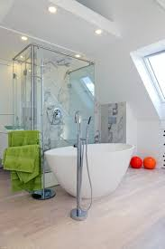 modern dynamic budapest apartment with colorful touches digsdigs a bathtub in a bedroom is a hot decor trend this area is clad with