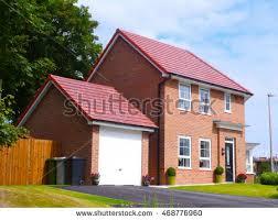 House With Garage Brinkstock U0027s Portfolio On Shutterstock