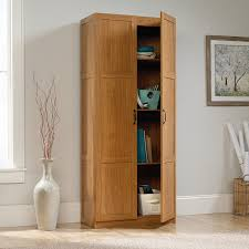 sauder kitchen furniture amazon com sauder storage cabinet highland oak finish kitchen