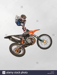 freestyle motocross riders freestyle moto fmx riders in mid air stock photo royalty free