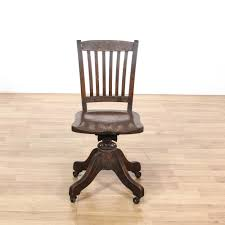 wooden rolling desk chair this antique desk chair is featured in a solid wood with a glossy