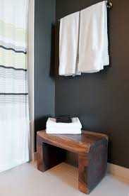 cozy bathroom with wooden bathroom bench seat and stools under