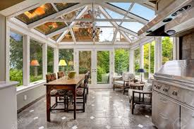 sunroom dining room sunroom patio area with transparent vaulted ceiling steel