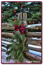 Primitive Holiday Decor Evergreen Swags Decorating The Fence Along The Lane That Leads To