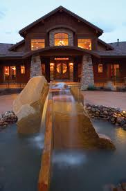luxury craftsman style home plans cool waterfall in front of this home plan 101s 0001