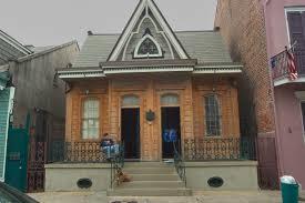 a double gothic revival style shotgun house with fleur de lis
