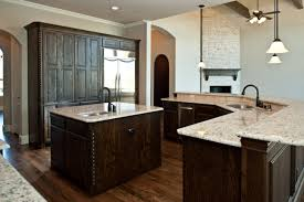 kitchen with island and breakfast bar maple wood autumn shaker door kitchen island breakfast bar