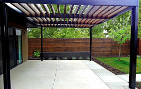 custom modern metal arbor on contemporary concrete patio mile