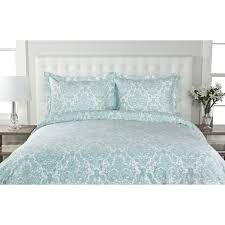 this stunning cotton duvet cover set features a fl dumask print in ivory blue or grey tones conveniently machine washable this set is both modern and