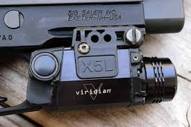 sig sauer laser light combo viridian s x5l laser light will have your enemies seeing green