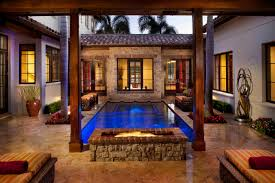 homes with interior courtyards pick your pit our top outdoor fireplaces cahill homes