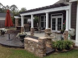 this craftsman style house backyard pergola grilling station