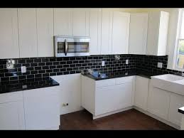 black backsplash in kitchen backsplash ideas for black granite countertops and white cabinets