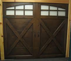 steel garage door faux painted to look like wood garage door