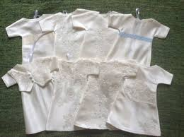 woman had wedding dress made into 16 tiny burial gowns after her