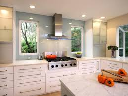 white kitchen cabinets white granite tops integrated light blue