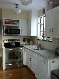 small kitchen design with island white marble countertop bronze