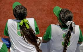 softball bows women s college world series hair bows and grit co exist on the