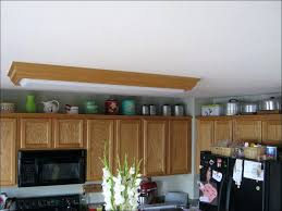 what do you put on top of kitchen cabinets what do you put on top of kitchen cabinets frequent flyer miles
