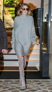 sweater dress and gigi hadid rocks a sweater dress and thigh high boots to the